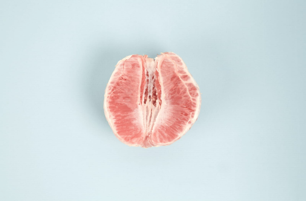 Half of a peeled grapefruit that resembles a tightened vaginal opening.