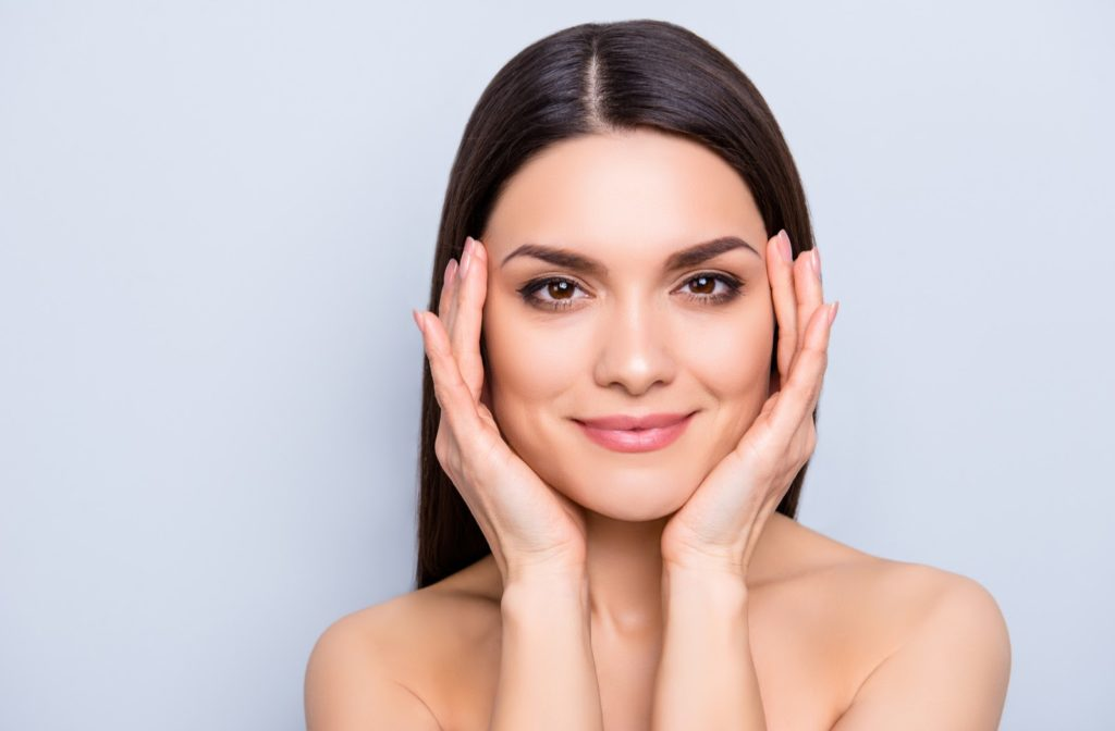 woman enjoying her fresh, youthful appearance after a nonsurgical facelift