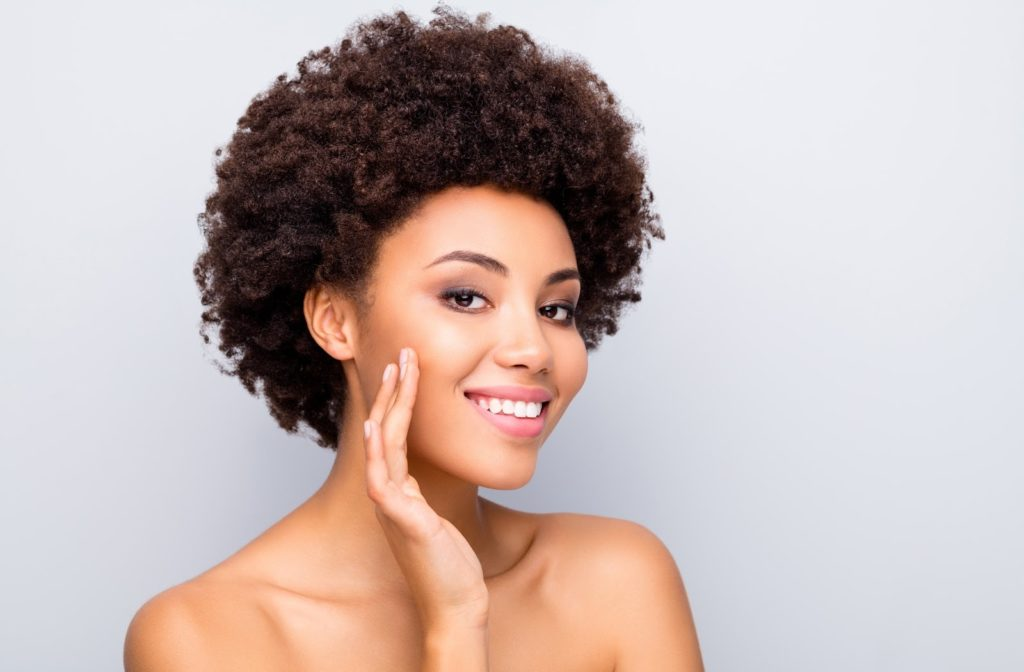 A woman smiling with clear skin.